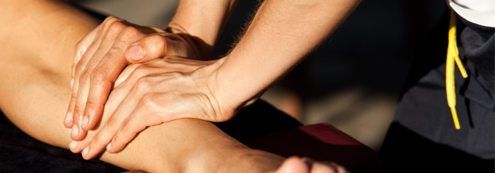 women pressing hands on forearm